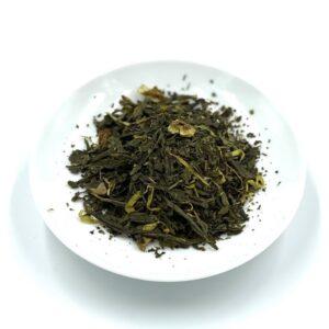 Raikas ja lämmittävä vihreä tee, johon on lisätty inkivääriä, sitruunan kuorta ja kehäkukan terälehtiä.